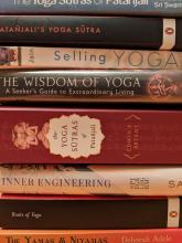 A stack of yoga books